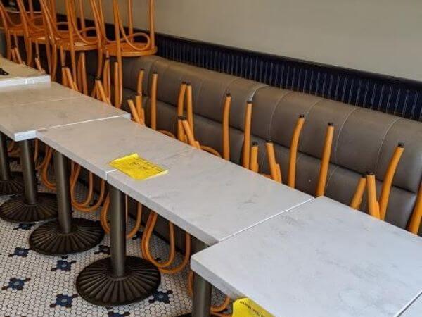 Empty banquettes inside a Campbell, CA dining establishment